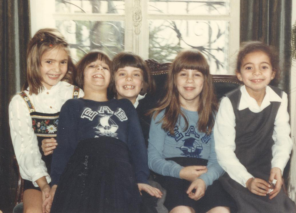 Me (second from right) and my twin sister (second from left) with school friends in Paris, age 7